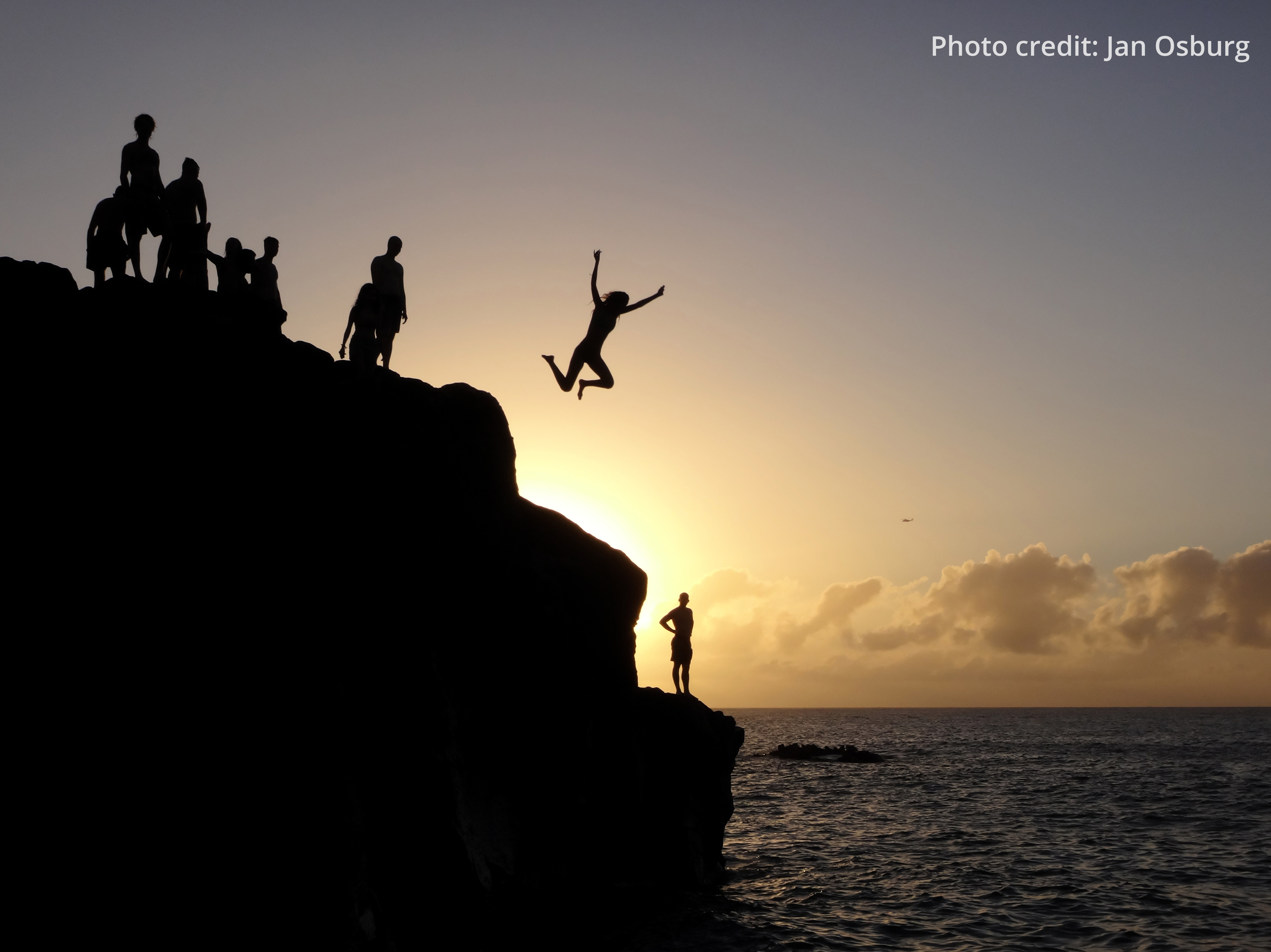 Cliff divers at sunset