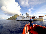 Research teams launch from the NOAA Ship Hi'ialakai to conduct coral reef surveys around the remote, unpopulated, volcanic island of Asuncion within the Marianas Trench Marine National Monument. Credit: NOAA, James Morioka