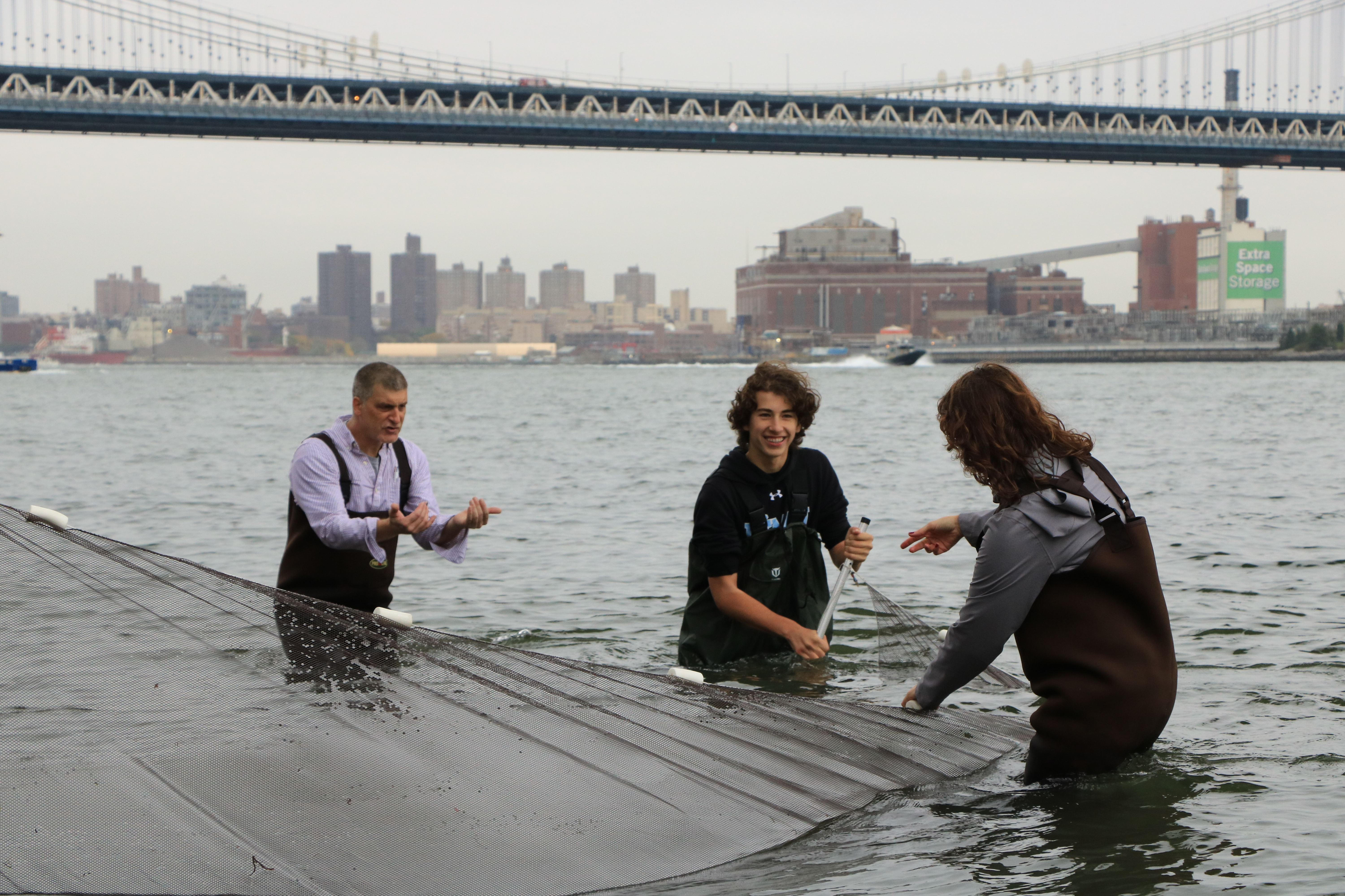 Students using a seine net during the event