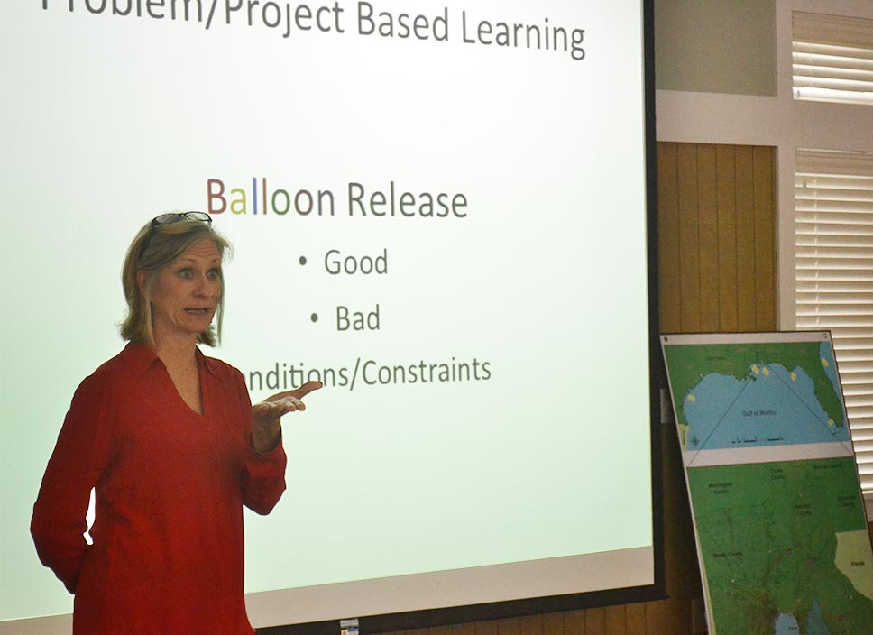 Woman speaking in front of screen during a Teachers on the Estuary workshop