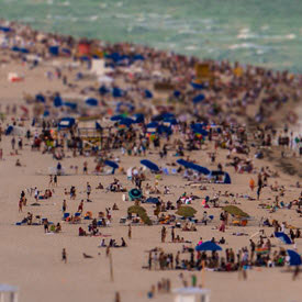 People on beach illustrating US coastal population